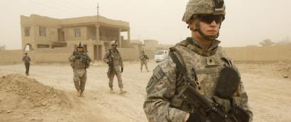 US soldiers and Iraqi police carry out t