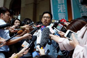 Pro-democracy activist Nathan Law is interviewed by journalists outside the Final Court of Appeal after being granted bail in Hong Kong